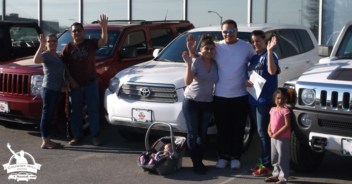 Multiple happy used car purchasers from Country Hill Motors in Kansas City