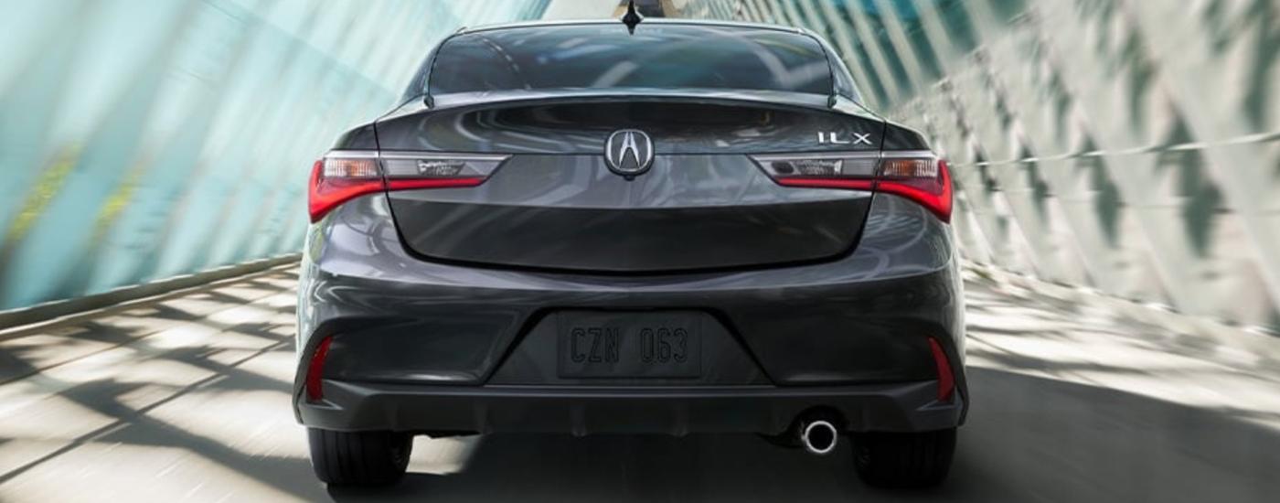 Gray 2020 Acura ILX Driving through bridge