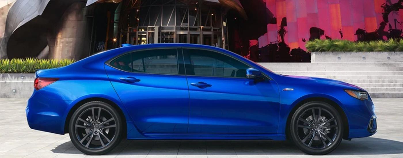 acura sedan in front of modern
