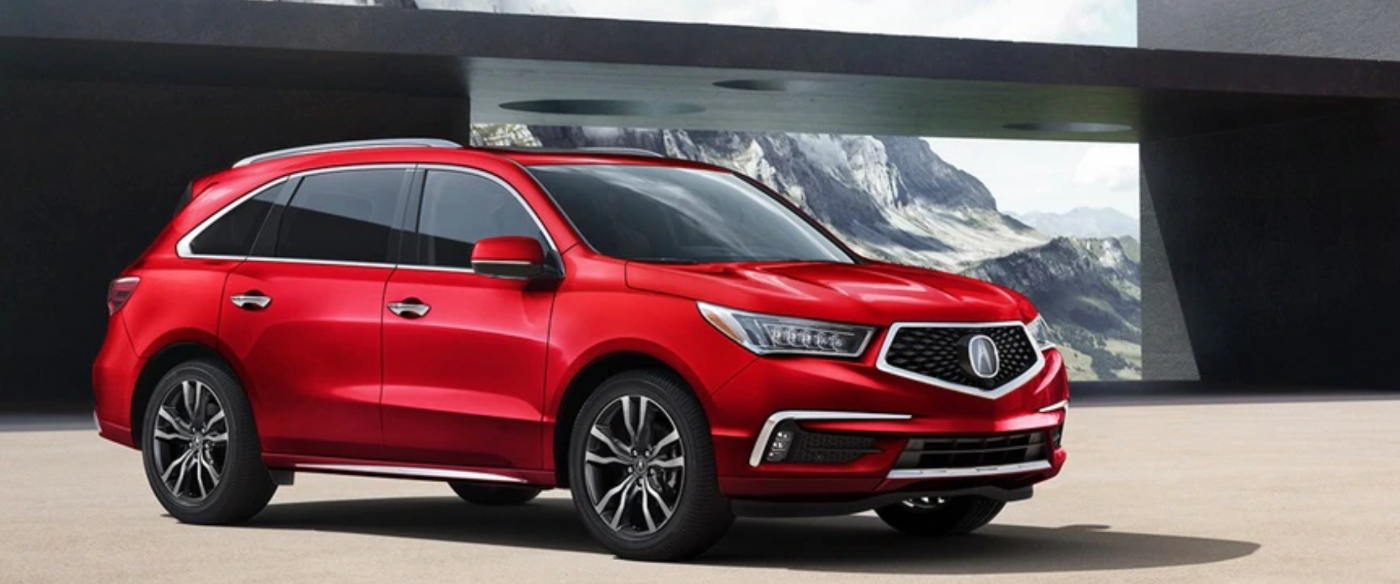 red acura mdx in front of modern garage
